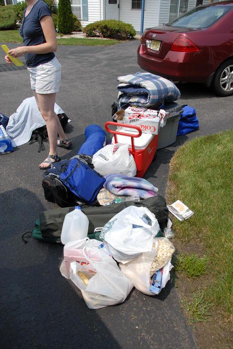 Rebecca, bags, camping supplies, food, legs