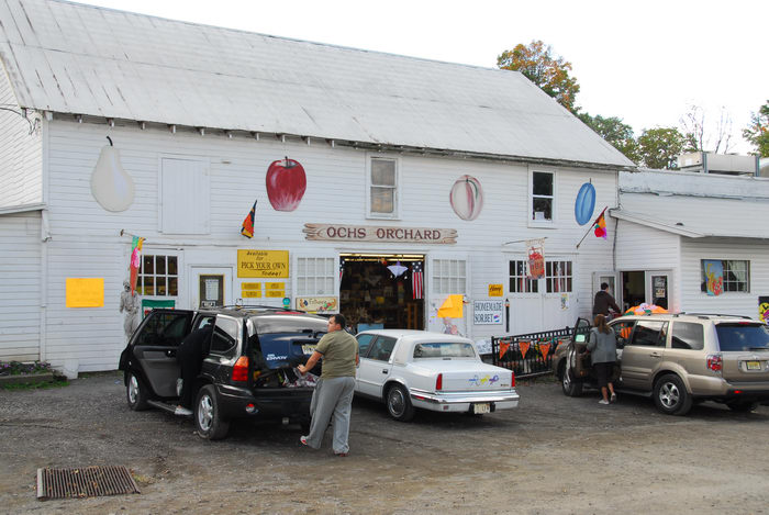 barn, cars, parking, people, signs