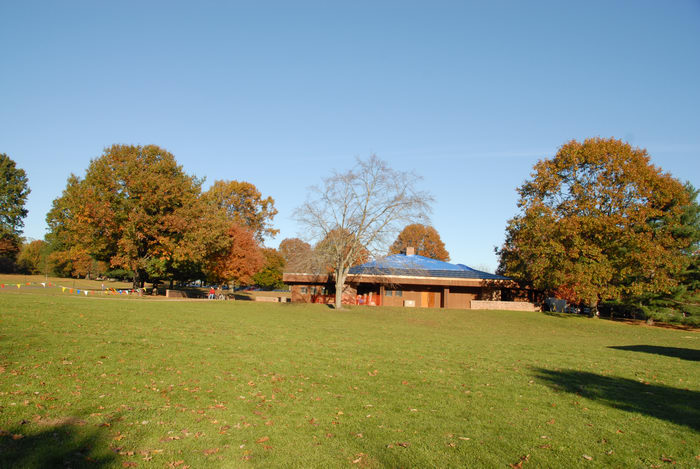 blue sky, building, fall colors, field, grass, open areas, trees