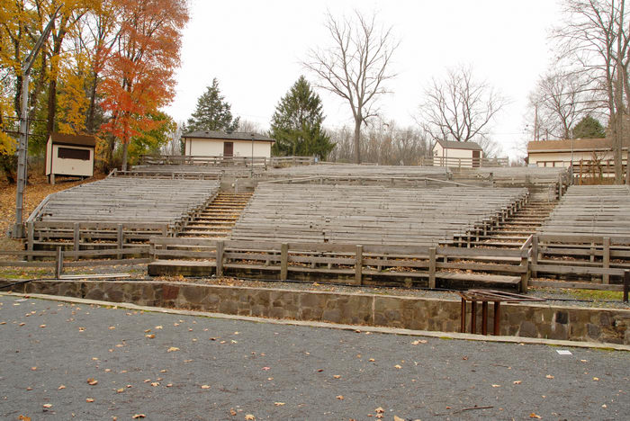 fall colors, leaves, seating, stage, theater, trees