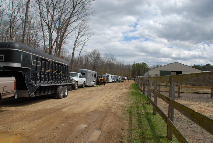 barn, dirt road, fence, trailers