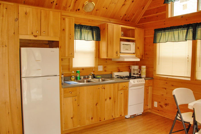 cabin, chair, fridge, kitchen, oven, sink, stove, wondow