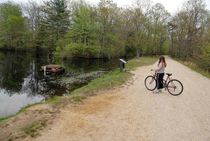 Jackie, bike, dirt road, mountain bike, path, sign, trail, trees, water, woods