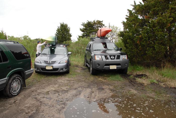 2006 Nissan Xterra, car, kayak, mud, puddle, tree