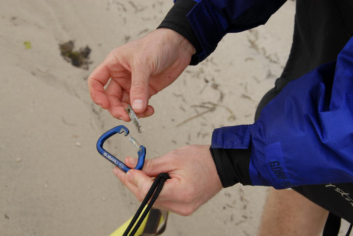 Rob, carabiner, hands, kayak, sand
