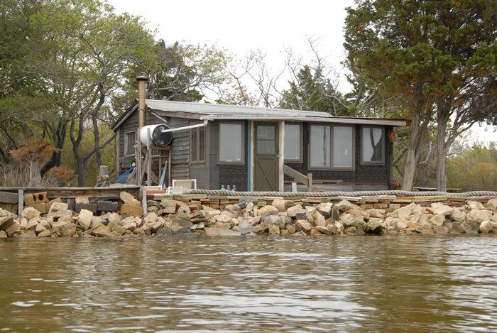 house, rocks, water