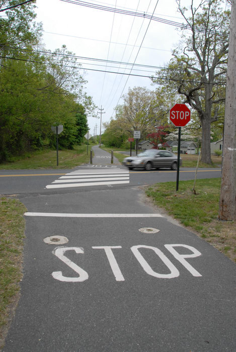 car, crossing, path, paved, road, stop sign, trees