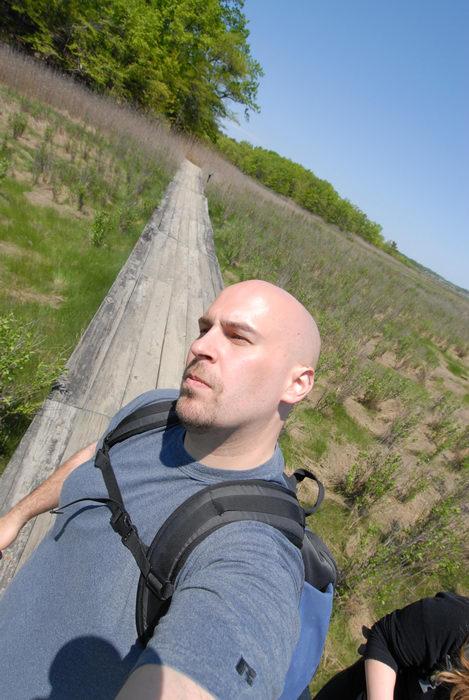 Jeff, blue sky, boardwalk, grass, trees