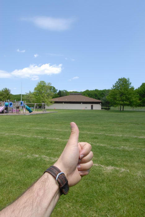 Thumbs across America, blue sky, grass, trees
