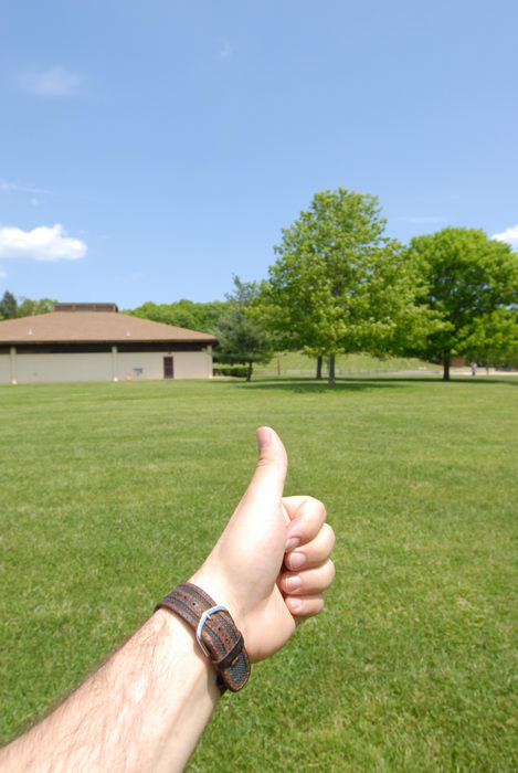 Thumbs across America, blue sky, building, grass, trees
