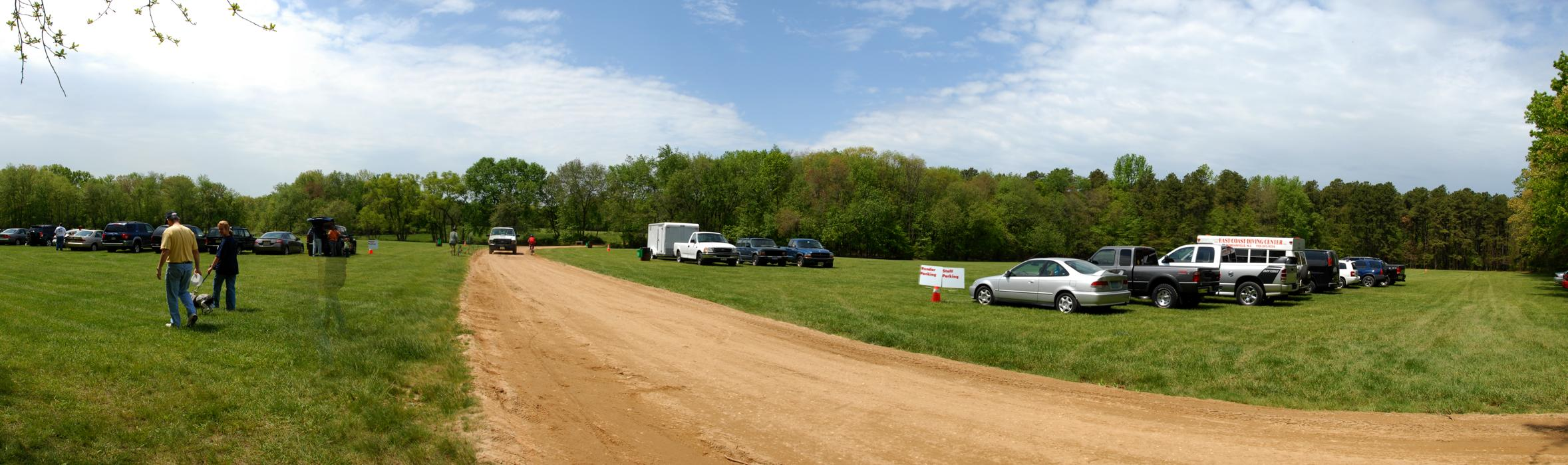 blue sky, cars, grass, panoramic, people, road, trees, woods