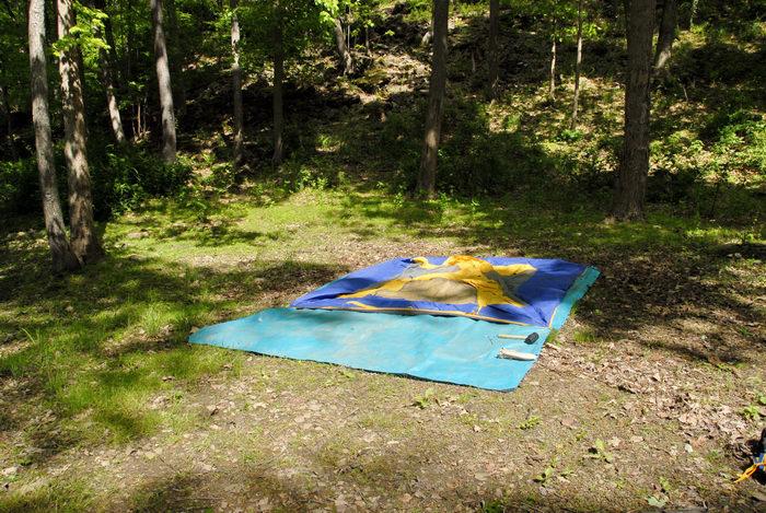 grass, rubber mallet, tarp, tent, woods
