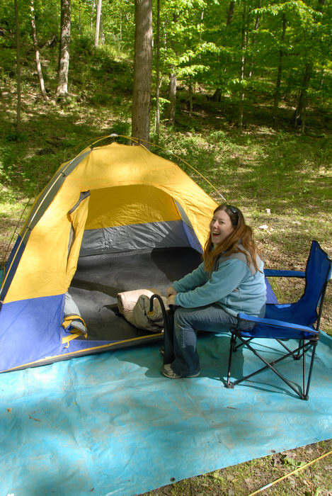 Jackie, blow up mattress, camping chair, laughing, tarp, tent