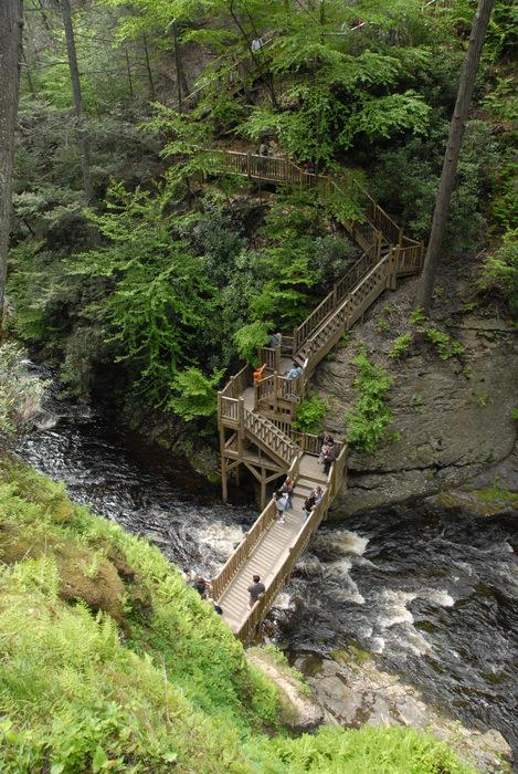 bridge, cliff, railing, river, rock, stairs, trees, wooden walkway