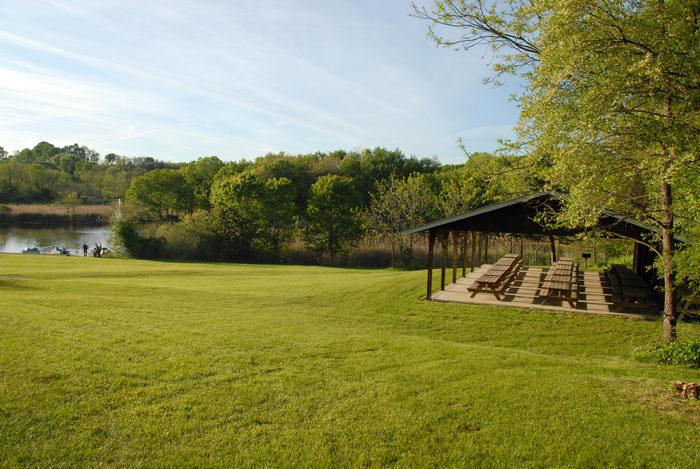 field, grass, picnic shelter, water
