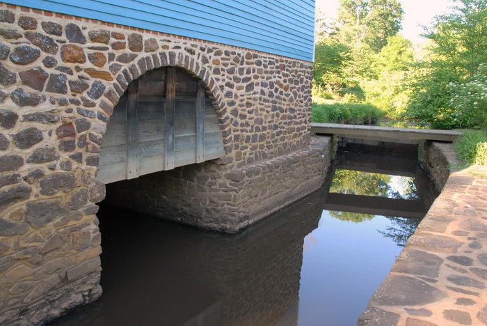 blue, bridge, canal, flowers, foundation, gristmill, rock, trees, vleaves, water, wood