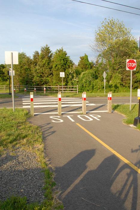 bike path, dirt, grass, road, sign, trees