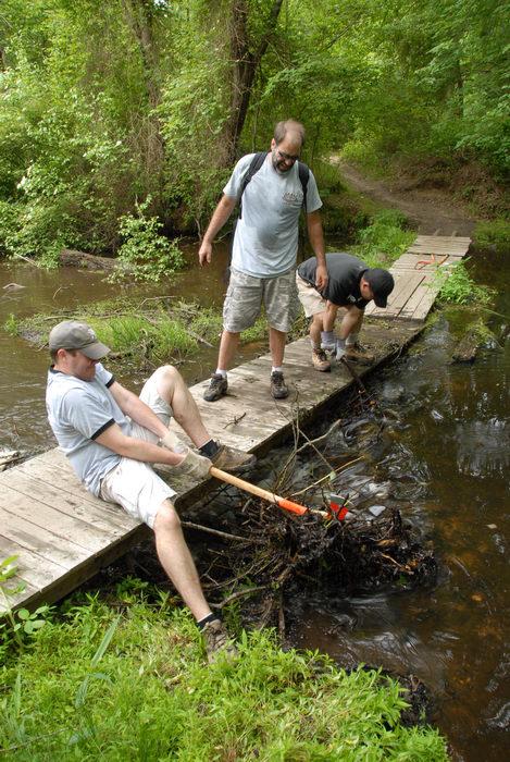 S.M.A.R.T., SMART, beaver dam, bridge, garbage bridge, ground cover, path, tools, trail, trail maintenance, trees, wooden bridge, woods