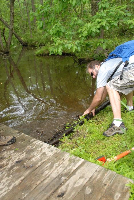 S.M.A.R.T., SMART, beaver dam, bridge, garbage bridge, ground cover, stream, tools, trail maintenance, water, wooden bridge