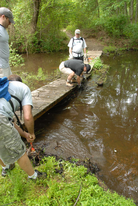 S.M.A.R.T., SMART, bridge, garbage bridge, grass, ground cover, path, stream, tools, trail, trail maintenance, trees, water, wooden bridge, woods