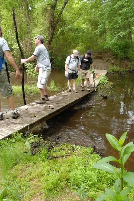 S.M.A.R.T., SMART, beaver dam, bridge, garbage bridge, grass, ground cover, path, stream, trail, trail maintenance, trees, water, wooden bridge, woods