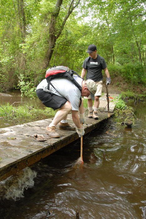 S.M.A.R.T., SMART, beaver dam, bridge, garbage bridge, path, stream, tools, trail, trail maintenance, trees, water, wooden bridge, woods