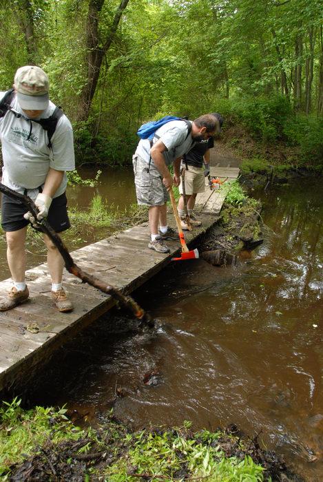 S.M.A.R.T., SMART, beaver dam, bridge, garbage bridge, stream, tools, trail maintenance, trees, water, wooden bridge, woods