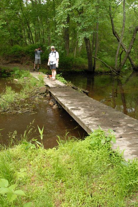 S.M.A.R.T., SMART, bridge, garbage bridge, grass, ground cover, stream, trail maintenance, trees, water, wooden bridge, woods