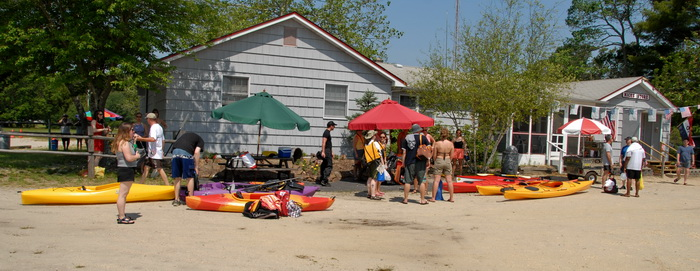 blue sky, kayak, kayaking, paddling, parking lot, trees, umbrella, building