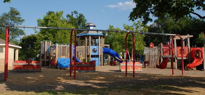play area, playground, blue sky, trees, swings, slide, wooden