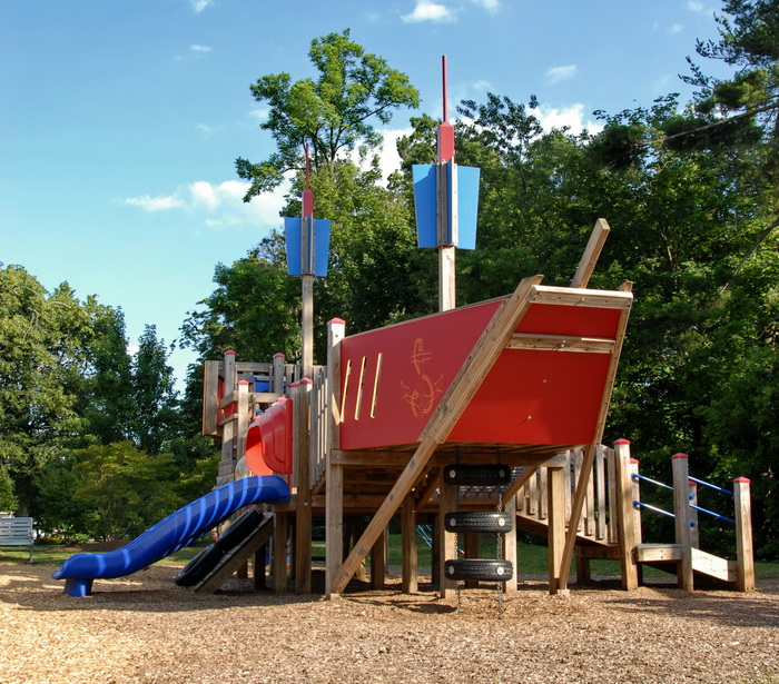 play area, playground, ship, trees, blue sky, wood chips