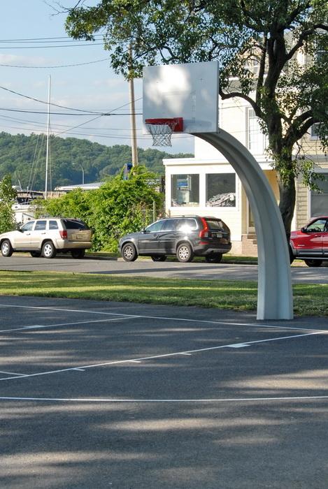 basketball court, basketball net, backboard, cars, road, tree