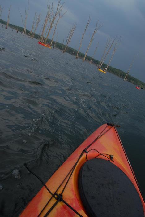 dead trees, kayak, kayaking, lake, paddling, people, reservoir, storm clouds, water