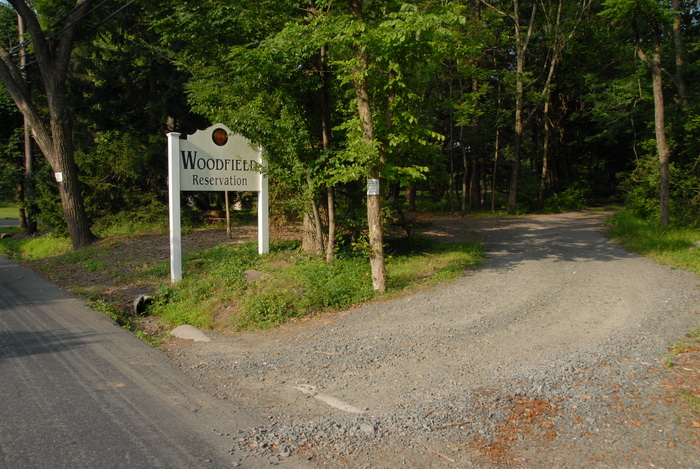 dirt road, entrance, sign, trees, woods, grass