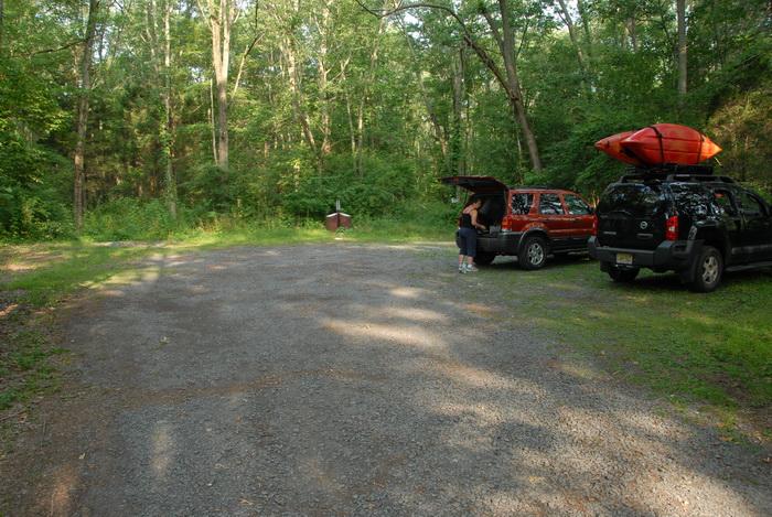 My XTerra, dirt parking lot, ground cover, parking lot, trees, woods, grass