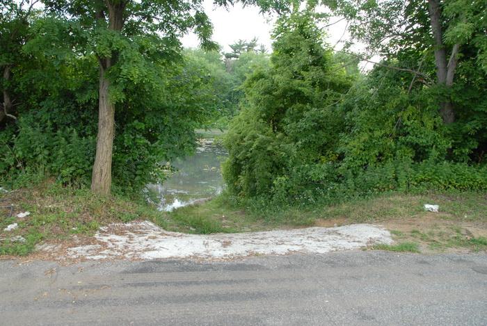 Millhurst Mills Lake, grass, launch ramp, parking lot, trees, water