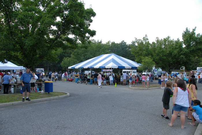 canopy, festival, grass, people, trees, parking lot