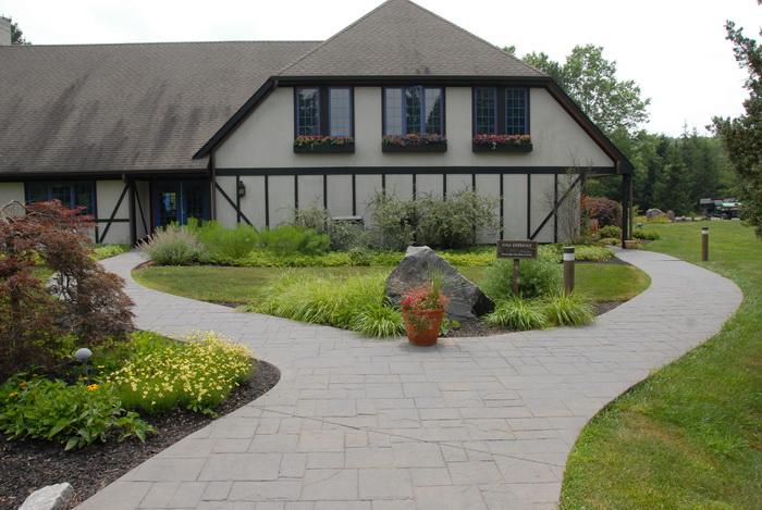 walkway, path, grass, bushes, building, rock, windows, flowers
