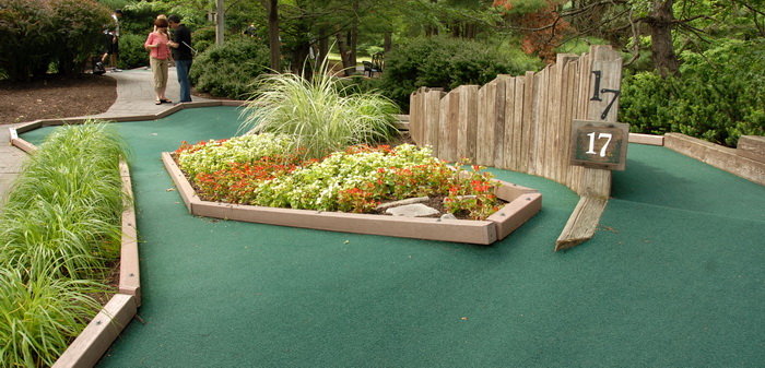 flowers, golf green, grass, holf 17, minigolf, obstacle, people, sign