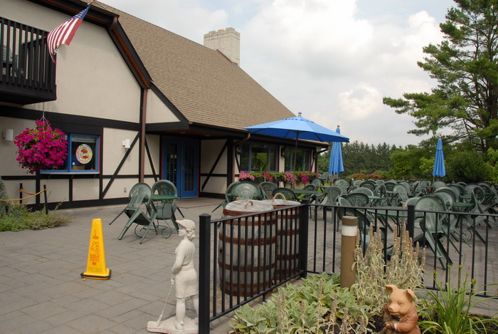 clubhouse, tables, fence, statue, building, umbrella
