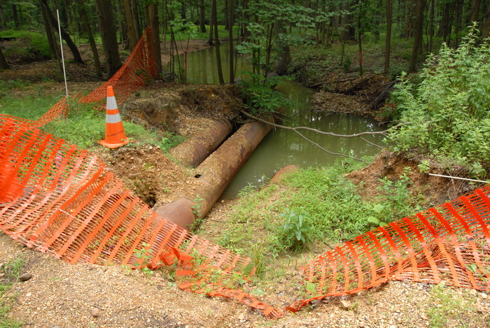 cone, pipe, snow fence, trees, water, woods