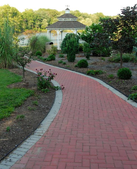 gazebo, brick path, dirt, water