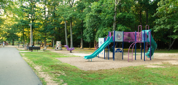 equipment, playground, sand, toys, grass, paved path