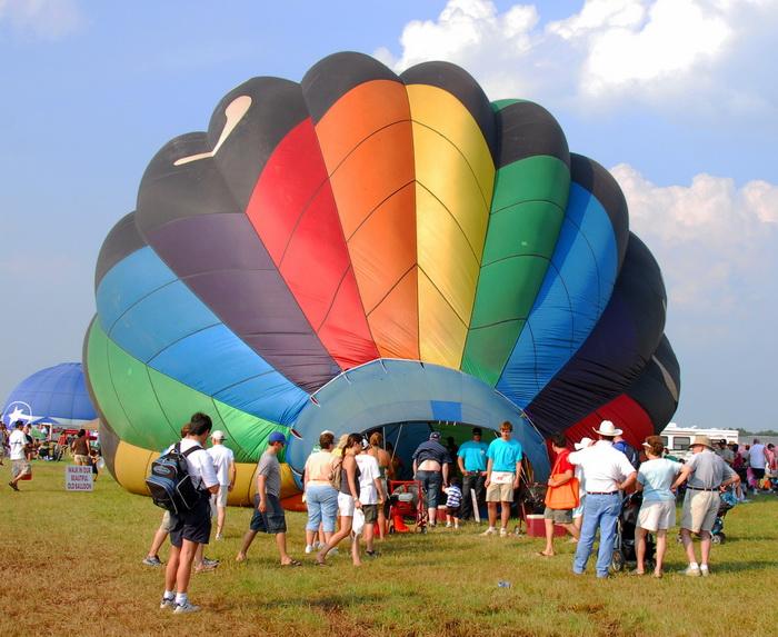 hot air balloon, people, grass, truck, SUV, field
