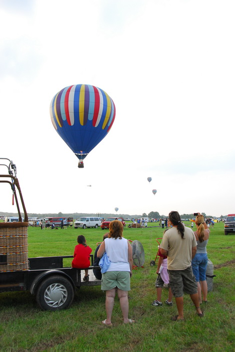 people, grass, hot air balloon, field, floating away