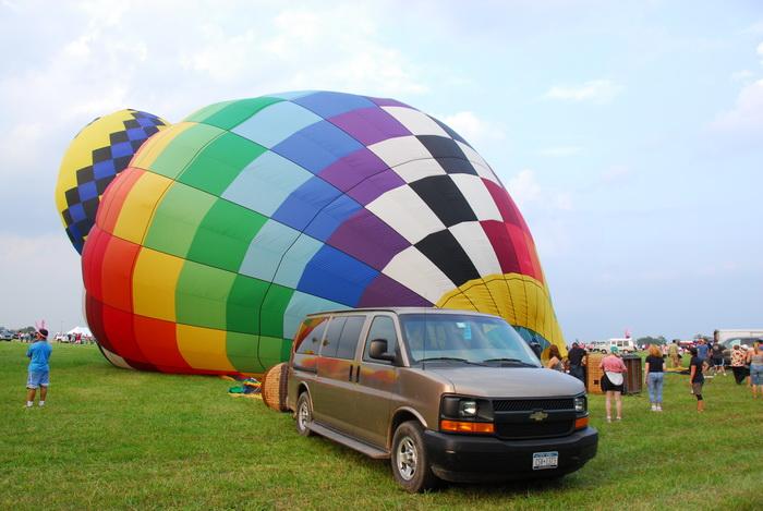 van, grass, field, inflating, hot air balloon, people