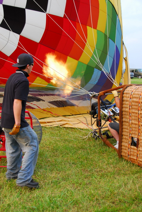 flame, rope, grass, worker, inflating, hot air balloon, inside, basket