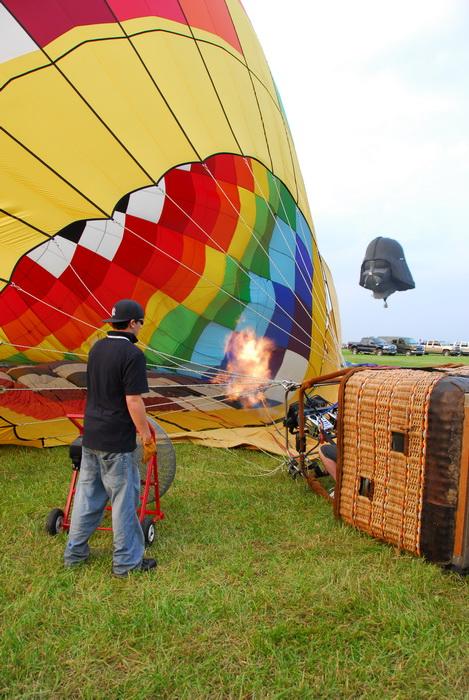 basket, flame, grass, hot air balloon, inflating, inside, rope, worker, darth vadar balloon