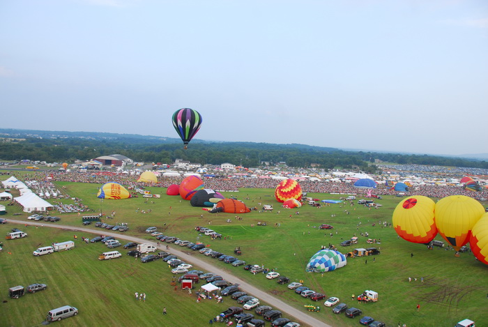 cars, crowd, festival, floating, hot air balloon, people