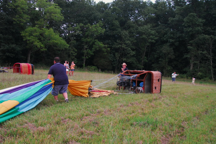 baset, basket, deflated, field, folding up, hot air balloon, ropes, workers